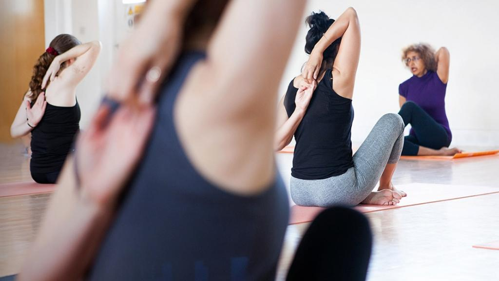 Yoga students learning what it takes to become a yoga instructor