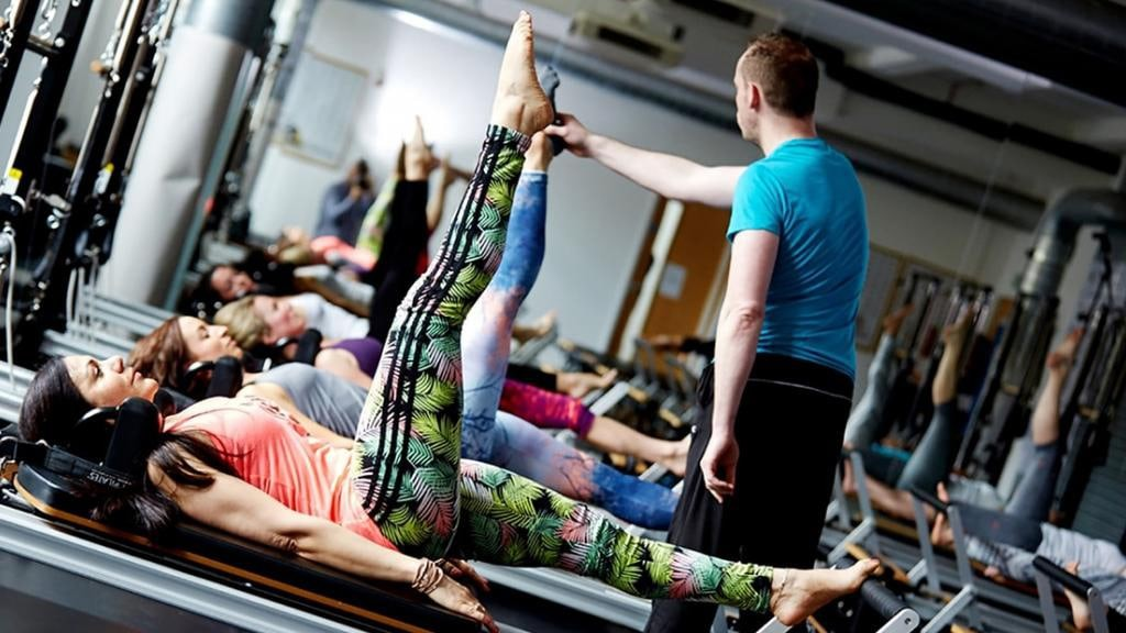 PIlates students learning what it takes to become a Pilates trainer
